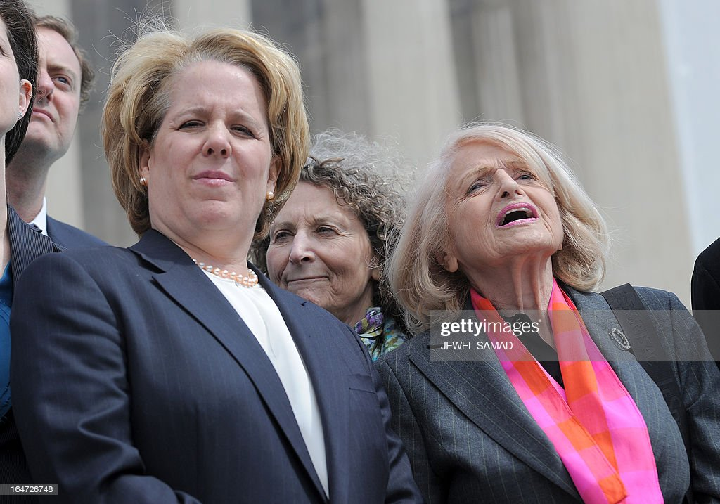 Plaintiff of the US v. Windsor case challenging the constitutionality of Section 3 of the Defense of Marriage Act (DOMA), 83-year-old lesbian widow Edie Windsor (R) and her lawyer Roberta Kaplan (L) arrive to make a statement to the media in front the Supreme Court on March 27, 2013 in Washington, DC. The US Supreme Court tackled same-sex unions for a second day Wednesday, hearing arguments for and against the 1996 US law defining marriage as between one man and one woman. After the nine justices mulled arguments on a California law outlawing gay marriage on Tuesday, they took up a challenge to the constitutionality of the federal Defense of Marriage Act (DOMA). The 1996 law prevents couples who have tied the knot in nine states -- where same-sex marriage is legal -- from enjoying the same federal rights as heterosexual couples. AFP PHOTO/Jewel Samad