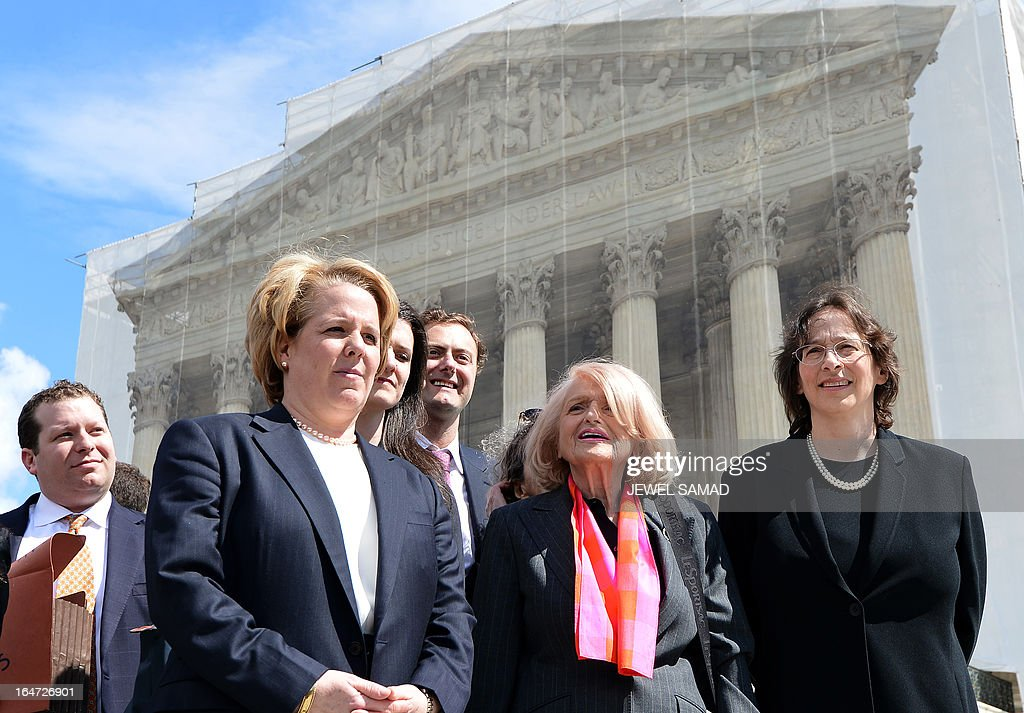 Plaintiff of the US v. Windsor case challenging the constitutionality of Section 3 of the Defense of Marriage Act (DOMA), 83-year-old lesbian widow Edie Windsor (C) and her lawyer Roberta Kaplan (L) arrive to make a statement to the media in front the Supreme Court on March 27, 2013 in Washington, DC. The US Supreme Court tackled same-sex unions for a second day Wednesday, hearing arguments for and against the 1996 US law defining marriage as between one man and one woman. After the nine justices mulled arguments on a California law outlawing gay marriage on Tuesday, they took up a challenge to the constitutionality of the federal Defense of Marriage Act (DOMA). The 1996 law prevents couples who have tied the knot in nine states -- where same-sex marriage is legal -- from enjoying the same federal rights as heterosexual couples. AFP PHOTO/Jewel Samad