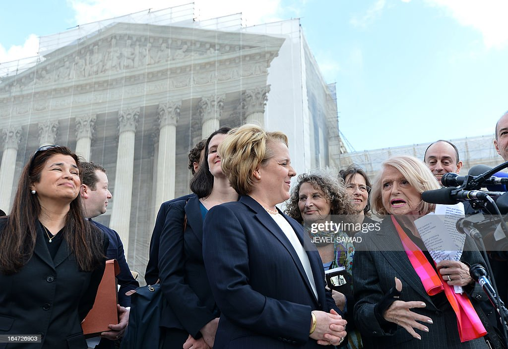 Plaintiff of the US v. Windsor case challenging the constitutionality of Section 3 of the Defense of Marriage Act (DOMA), 83-year-old lesbian widow Edie Windsor (R) makes a statement to the media as her lawyer Roberta Kaplan (C) looks on in front the Supreme Court on March 27, 2013 in Washington, DC. The US Supreme Court tackled same-sex unions for a second day Wednesday, hearing arguments for and against the 1996 US law defining marriage as between one man and one woman. After the nine justices mulled arguments on a California law outlawing gay marriage on Tuesday, they took up a challenge to the constitutionality of the federal Defense of Marriage Act (DOMA). The 1996 law prevents couples who have tied the knot in nine states -- where same-sex marriage is legal -- from enjoying the same federal rights as heterosexual couples. AFP PHOTO/Jewel Samad
