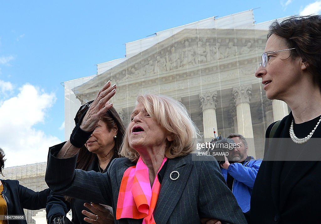 Plaintiff of the US v. Windsor case challenging the constitutionality of Section 3 of the Defense of Marriage Act (DOMA), 83-year-old lesbian widow Edie Windsor (C), blows a kiss to same-sex marriage supporters as she leaves the Supreme Court on March 27, 2013 in Washington, DC. The US Supreme Court tackled same-sex unions for a second day Wednesday, hearing arguments for and against the 1996 US law defining marriage as between one man and one woman. After the nine justices mulled arguments on a California law outlawing gay marriage on Tuesday, they took up a challenge to the constitutionality of the federal Defense of Marriage Act (DOMA). The 1996 law prevents couples who have tied the knot in nine states -- where same-sex marriage is legal -- from enjoying the same federal rights as heterosexual couples. AFP PHOTO/Jewel Samad