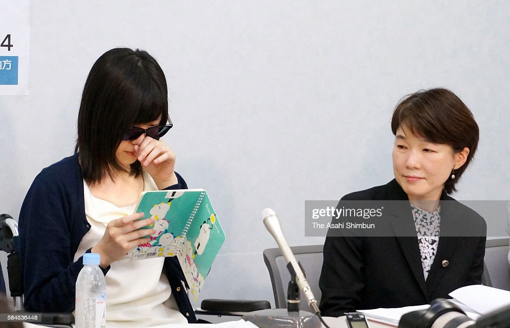 A plaintiff sheds tears while speaking during a press conference on July 27 2016 in Osaka Japan Sixtythree female plaintiffs between the ages of 15...