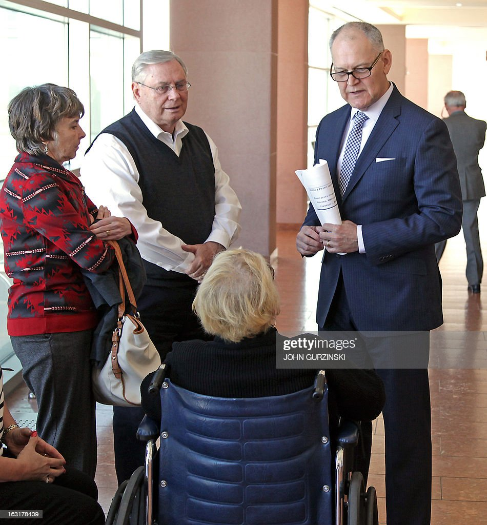 Plaintiffs Bonnie and Carl Brunson (L) confer with Helen Meyer (seated) and witness Wendell Potter (R), a former VP of Corporate Communications at CIGNA, following his testimony during a break in the trial against Health Plan of Nevada for the HMO's role in largest Hep C outbreak in US history on Tuesday March 5, 2013 in Las Vegas, Nevada. AFP PHOTO /John Gurzinski