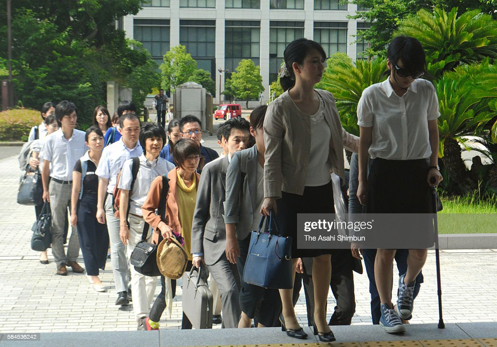 Plaintiffs enter the Fukuoka District Court to file a lawsuit on July 27 2016 in Fukuoka Japan Sixtythree female plaintiffs between the ages of 15...
