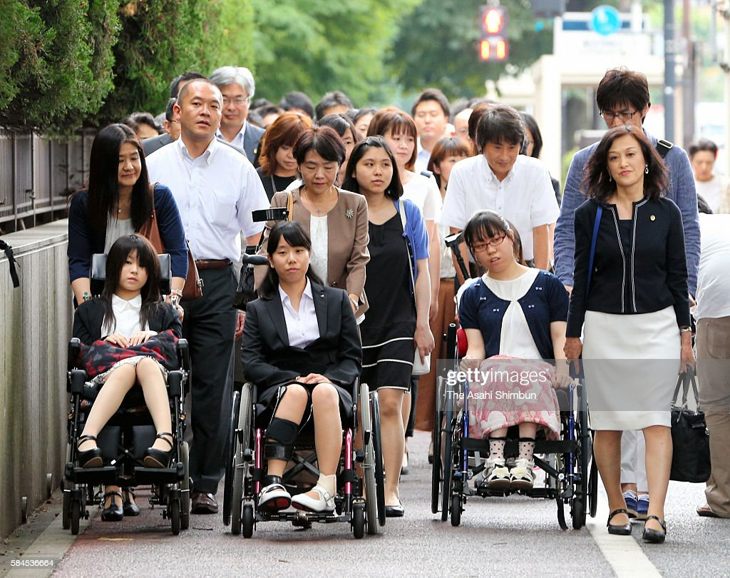 Plaintiffs enter the Tokyo District Court to file a lawsuit on July 27 2016 in Tokyo Japan Sixtythree female plaintiffs between the ages of 15 and 22...
