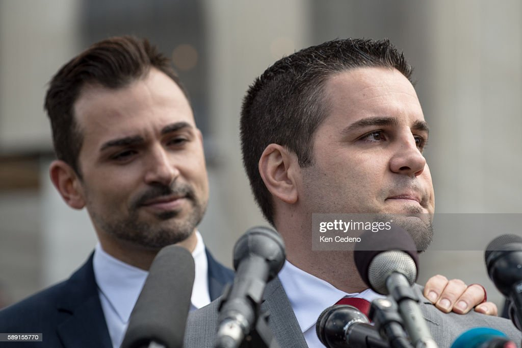 Plaintiffs Jeff Zarillo right gets support from his partner Paul Katami left as he speaks to the press at the US Supreme Court after oral arguments...