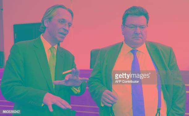 Plaintiffs' lawyer Andreas W Tilp and Attorney Albert W Adametz talk during the opening of a model proceeding brought by investors as part of a...