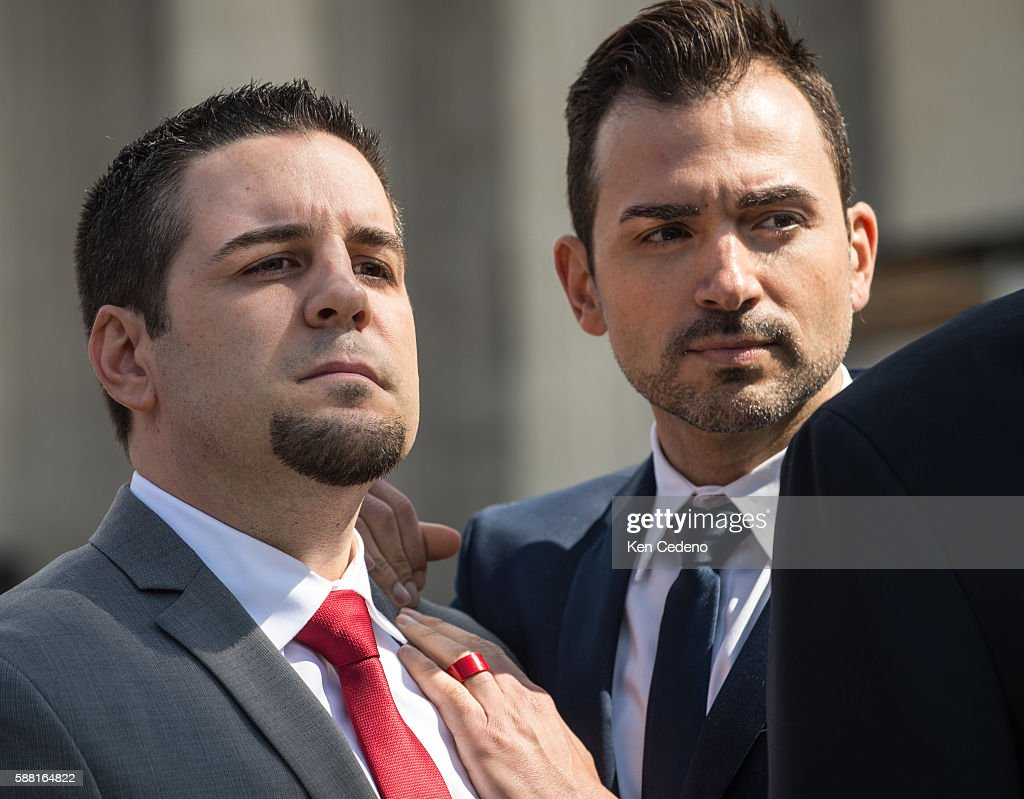 Plaintiffs Paul Katami left Jeff Zarillo second left listen to their attorneys as they speak to the press at the US Supreme Court after oral...