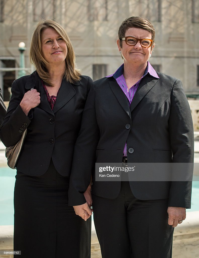 Plaintiffs Sandy Stier left and and Kris Perry right hold hands while they listen to their attorneys speak to the press at the US Supreme Court after...