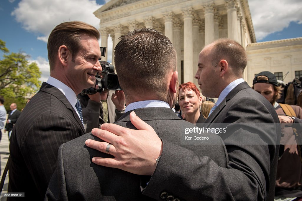 Plaintiffs Thomas Kostra center and his husband Ijpe Dekoe right from TN speak with the media outside the Supreme Court of the United States...