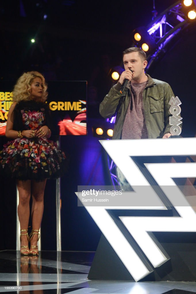Plan B accepts the award for Best Hip/Hop/Grime presented by <a gi-track='captionPersonalityLinkClicked' href=/galleries/search?phrase=Rita+Ora&family=editorial&specificpeople=5686485 ng-click='$event.stopPropagation()'>Rita Ora</a> onstage at the 2012 MOBO awards at Echo Arena on November 3, 2012 in Liverpool, England.