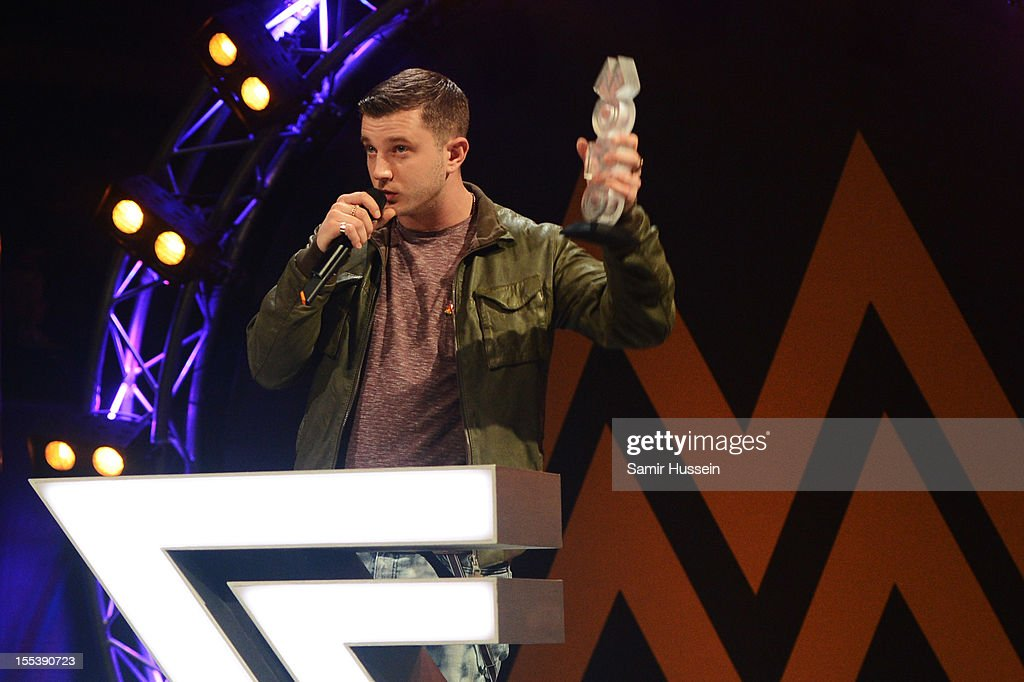 Plan B accepts the award for Best Male Act onstage at the 2012 MOBO awards at Echo Arena on November 3, 2012 in Liverpool, England.