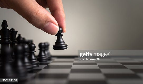 Plan leading strategy of successful business leader concept, Hand of player chess board game putting black pawn, Copy space for your text : Stock Photo