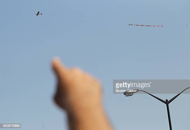 A plane and banner flew over the employees and customers holding a rally in support of Arthur T Demoulas and Market Basket