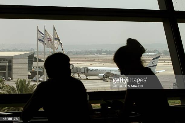 A plane belonging to Israel's national airline El Al sits on the tarmac of Ben Gurion International airport near Tel Aviv on July 23 as US Secretary...