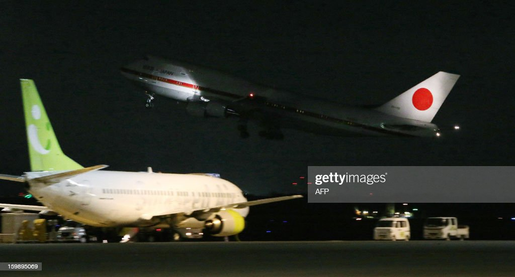 A plane carrying Japanese government representatives leaves the Tokyo International Airport, on their way to Algeria to bring home Japanese survivors and the bodies of seven Japanese victims of the recent hostage crisis in Algeria on January 22, 2013. All the workers were employees or contractors for Japanese engineering firm JGC.