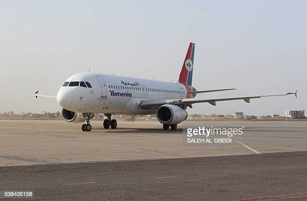 A plane coming from the Saudi capital Riyadh and carrying Yemen's prime minister taxies at the International Airport of the southern port city of...