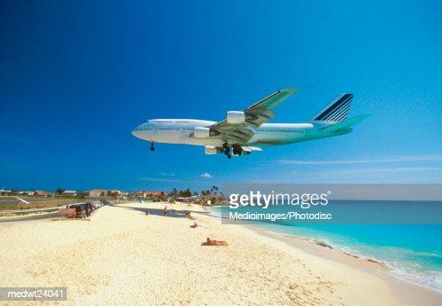 Plane coming in for landing on Maho Bay Beach, Saint Martin, Caribbean