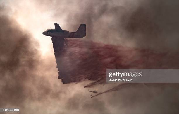 A plane drops fire retardant on an 80 acre spot fire that broke out in Butte County California on July 10 2017 More than a dozen wildfires were...