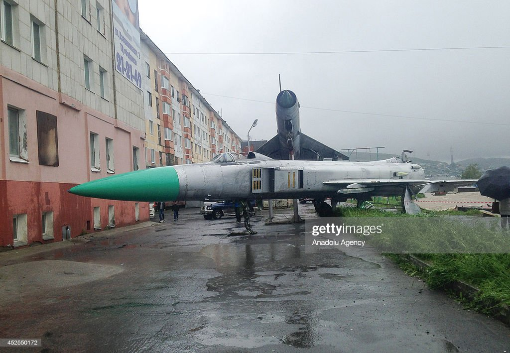A plane, exhibited in a museum, is adrift in flood water on July 23, 2014 in Magadan, Russia. Roads, many buildings and residential areas get damaged during flood disaster happened in Magadan.