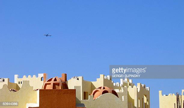 A plane flies above the popular Red Sea resort of Hurghada 17 April 2005 AFP PHOTO/ SERGEI SUPINSKY