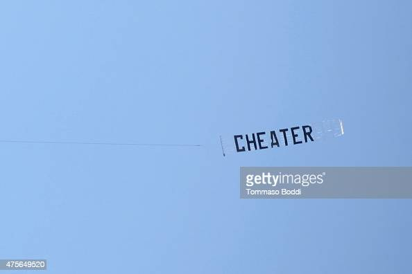 A plane flies nearby the ceremony honoring Bobby Flay as he receives a star on the Hollywood Walk of Fame on June 2 2015 in Hollywood California