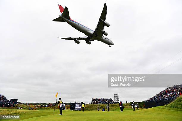A plane flies over the 8th green during the second round on day two of the 145th Open Championship at Royal Troon on July 15 2016 in Troon Scotland