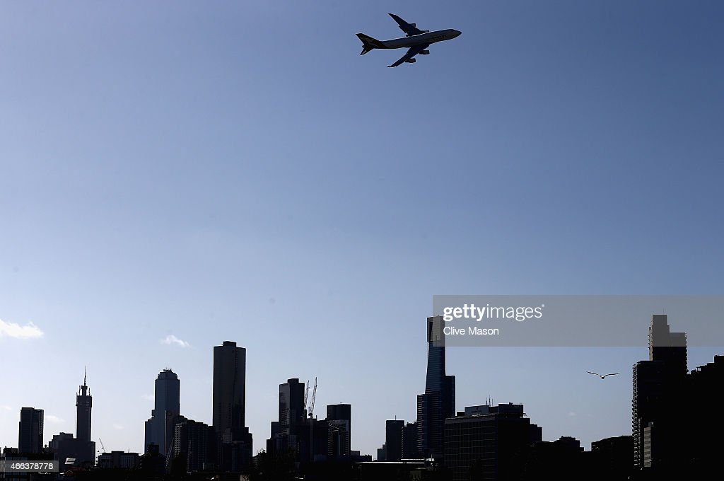 A plane flies over the city during the Australian Formula One Grand Prix at Albert Park on March 15 2015 in Melbourne Australia