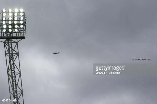 A plane flies over the Hawthorns stadium trailing an anti Arsene Wenger banner during the English Premier League football match between West Bromwich...