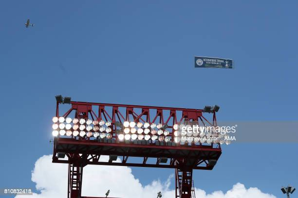 A plane flies overhead towing a banner promoting a preseason match between Tottenham Hotspur and Manchester City prior to the 2017 CONCACAF Gold Cup...