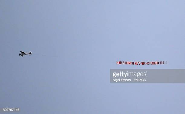 A plane flies past with a banner reading 'Had a hunch we'd win Richard III'