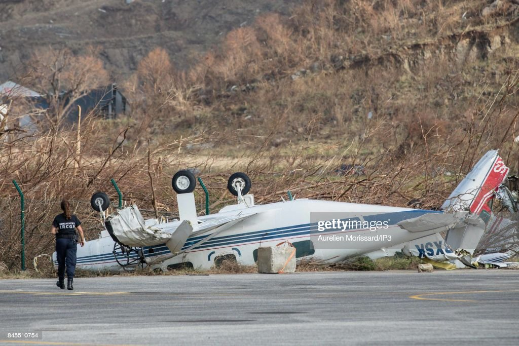 A plane flipped on its back at the airport of Saint Martin, after the passage of the hurricane IRMA through the Caribbean Islands. on September 10, 2017 in Saint Martin, France.