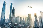 A Plane fly over Shanghai.