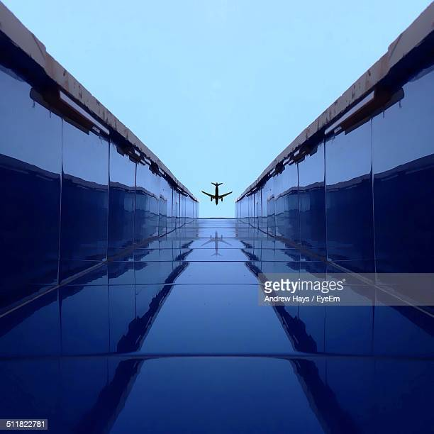 Plane flying above a building
