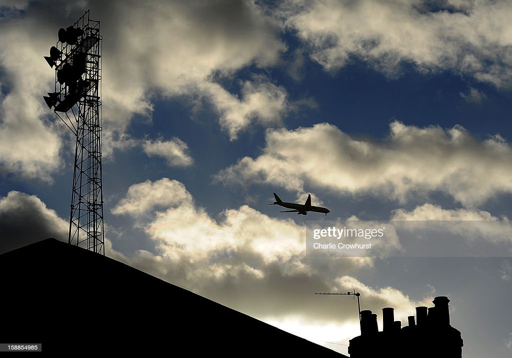 A plane flys over Griffin Park before the npower League One match between Brentford and Bournemouth at Griffin Park on January 01, 2013 in London England.