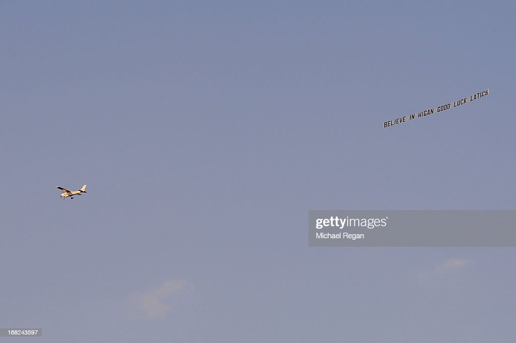 A plane flys over the stadium with a banner reading 'Believe in Wigan Good Luck Latics' prior to the Barclays Premier League match between Wigan Athletic and Swansea City at DW Stadium on May 7, 2013 in Wigan, England.