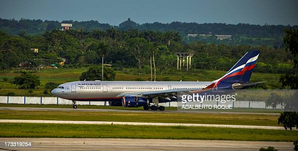 A plane from Russian airline Aeroflot with the number 150 lands at Jose Marti airport in Havana on July 11 2013 Cuban leader Raul Castro on Sunday...