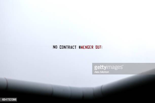 A plane is seen flying over the stadium with a message for Arsene Wenger during the Premier League match between West Bromwich Albion and Arsenal at...
