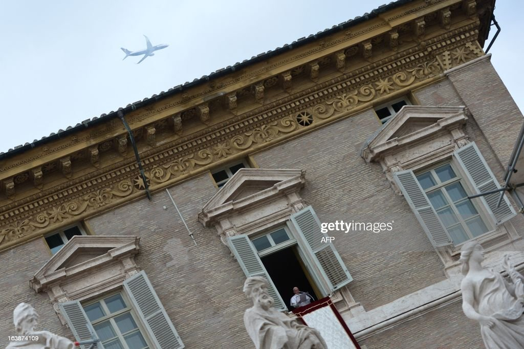 A plane is seen in the sky as Pope Francis leads the Angelus prayer at St Peter's square on March 17, 2013 at the Vatican. Pope Francis begins his papacy in earnest today ahead of his formal inauguration mass, with a weekly prayer address used by previous pontiffs to comment on international affairs. The pope's first Angelus prayer, delivered from a window high above St Peter's Square, is a chance for the first Latin American pontiff to begin to sketch out a more global vision for the role of the Roman Catholic Church. AFP PHOTO / GABRIEL BOUYS