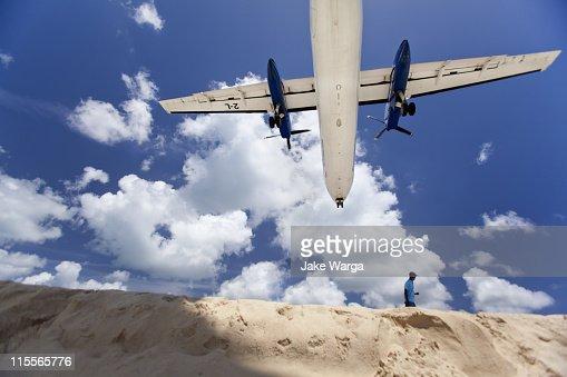 Plane landing over beach : Stock Photo