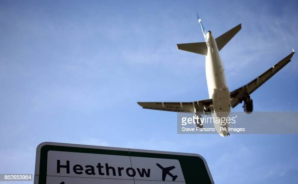 A plane lands on the southern runway at Heathrow Airport
