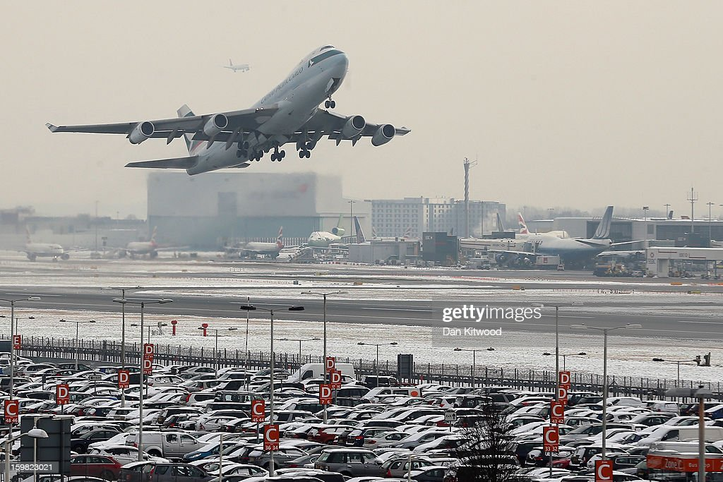 A plane leaves Heathrow airport on January 21, 2013 in London, England. Around 260 flights have been cancelled today from Heathrow due to snow and poor visibility.