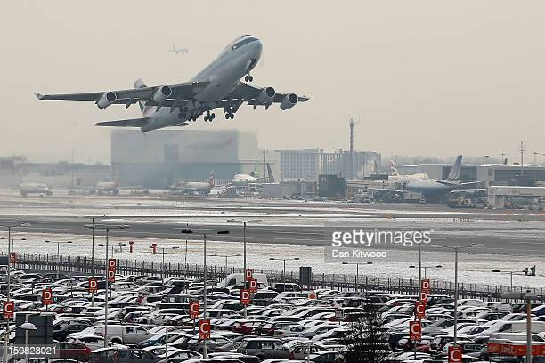 A plane leaves Heathrow airport on January 21 2013 in London England Around 260 flights have been cancelled today from Heathrow due to snow and poor...