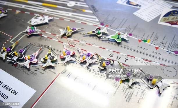 Plane models representing aircraft on the flight deck are seen on the ship's 'Ouija Board' on July 14 2017 in Townsville Australia USS Ronald Reagan...