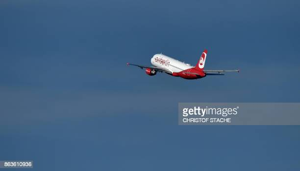 A plane of German airline Air Berlin takes off at FranzJosefStrauss airport in Munich southern Germany on October 20 2017 Lufthansa the largest...