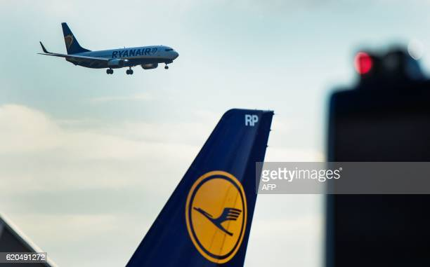 A plane of Irish lowcost airline Ryanair lands at the airport in Frankfurt am Main western Germany as in foreground can be seen the logo of German...