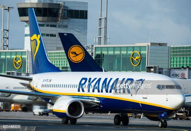 A plane of Irish lowcost airline Ryanair stands in front of an airplane of German airline Lufthansa on November 2 2016 in Frankfurt am Main western...