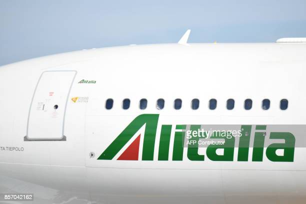 A plane of Italian airline Alitalia is pictured on the tarmac of Rome Fiumicino airport on September 6 2017 in Fiumicino / AFP PHOTO / Andreas SOLARO