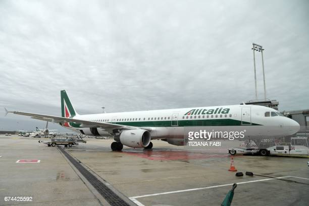 A plane of the Italian airline company Alitalia is parked at Rome's Fiumicino airport on April 28 2017 / AFP PHOTO / Tiziana FABI