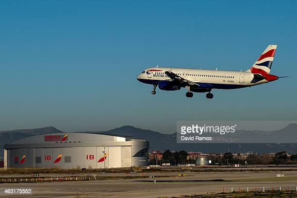 A plane operated by British Airways lands at Aena operated Barcelona El Prat International Airport on February 10 2015 in Barcelona Spain Shares in...