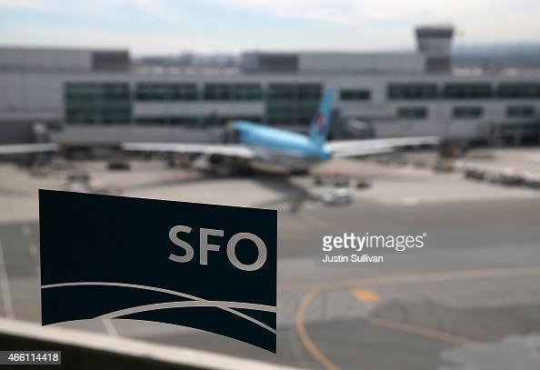 A plane parked at the international terminal is seen through the window of a sky train station at San Francisco International Airport on March 13...